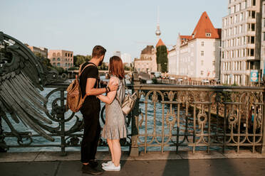Affectionate young couple on a bridge in the city, Berlin, Germany - VBF00003