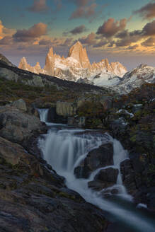Mount Fitz Roy and waterfall at sunrise in Autumn, El Chalten, Patagonia, Argentina - LOMF01098
