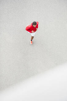 Top view of young man running on a lane - DIGF10815