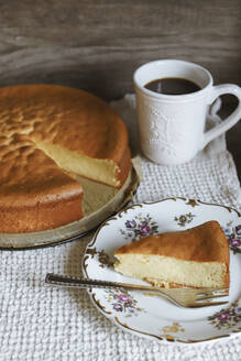 Marzipan cake slice on plate and coffee cup - VBF00053