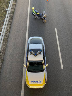 High angle view of police car and motorcycle on highway - OCMF01218