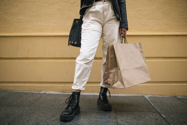 Crop view of woman with shopping bags in the city - GRCF00232