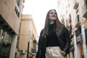 Portrait of happy young woman in the city - GRCF00235