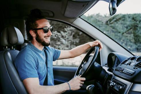 Happy man driving car - EBBF00067