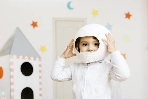 Girl playing astronaut at rocket - JRFF04456