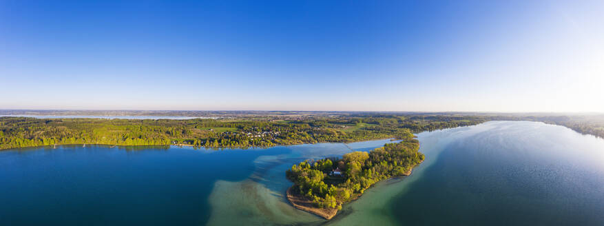 Germany, Bavaria, Inning am Ammersee, Drone panorama of clear sky over forested shore of Worth island - SIEF09843