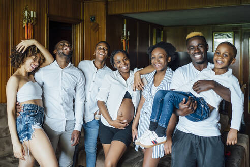 Portrait of happy family and friends at home - OCMF01239