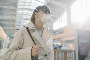 Portrait of woman wearing face mask in a shopping center - AHSF02603