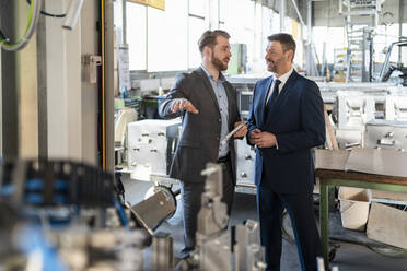 Two businessmen having a meeting in a factory - DIGF11053
