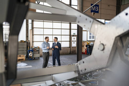 Two businessmen having a meeting in a factory - DIGF11077