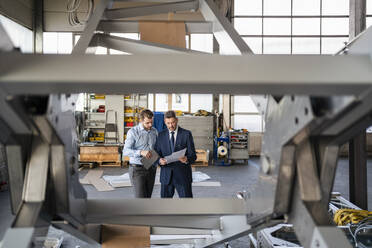 Two businessmen having a meeting in a factory - DIGF11080