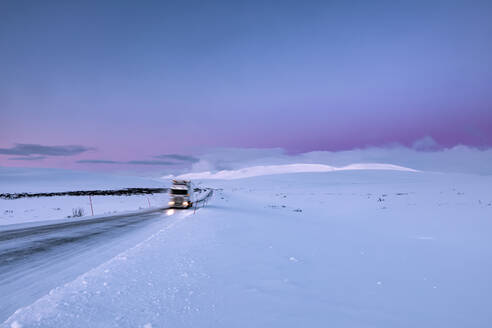 Truck on country road in winter, Tana, Norway - WVF01579