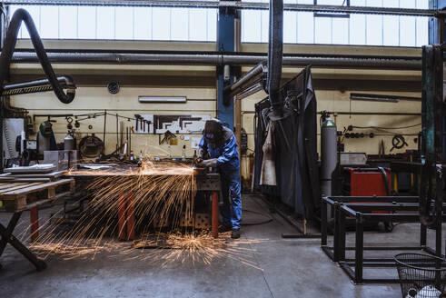 Welder welding metal in a factory - DIGF11359