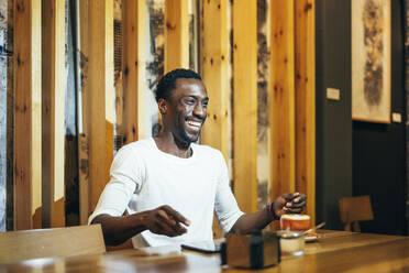 Madrid Spain, african man in coffee shop - OCMF01258