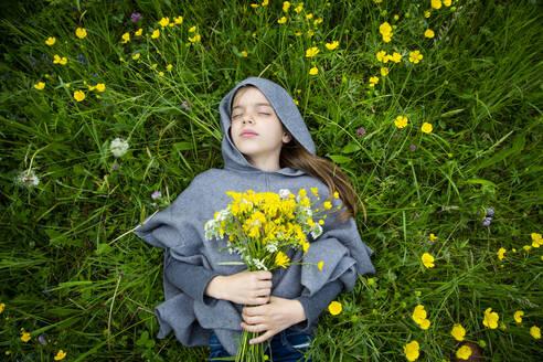 Girl picking yellow wildflowers - LVF08914
