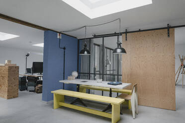 Table and benches in modern office - GUSF03847