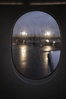 South Africa, Johannesburg, Airplane window with raindrops - VEGF02343