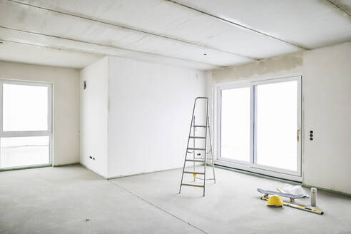 Room with ladder on construction site - MJFKF00223