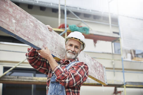 Construction worker working at construction site - MJFKF00307