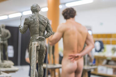 Sculpture and naked model in the background - FBAF01558