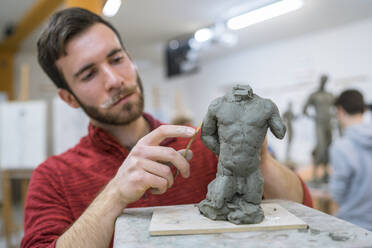 Student forming sculpture - FBAF01573