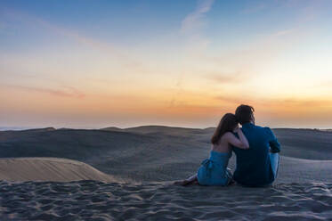 Couple at sunset in the dunes, Gran Canaria, Spain - DIGF12558