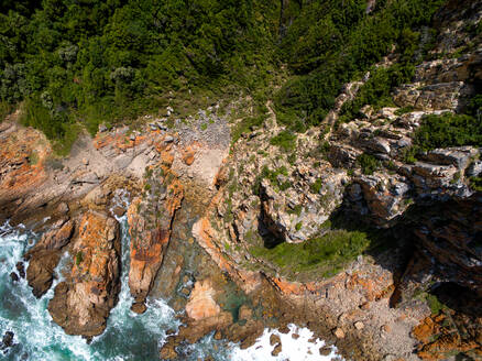 Aerial view of steep cliffs and forested area close to Noetzie Beach in Knysna, Western Cape, South Africa - AAEF08693