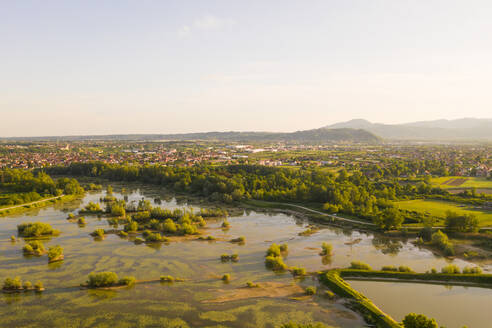 Aerial view of small wetland near Oresje settlement during sunset, Zagreb, Croatia. - AAEF08735