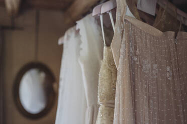Wedding dresses hanging on coathanger - ALBF01274