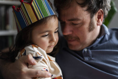 Portrait of little girl celebrating birthday with her father - VABF03014