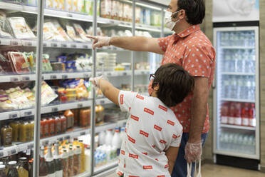 Father and son with masks in supermarket - VABF03039