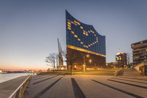 Germany, Hamburg, Heart shape displayed on Elbphilharmonie at dusk - KEBF01536