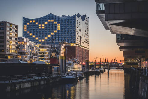 Germany, Hamburg, Heart shape displayed on Elbphilharmonie at dusk - KEBF01539