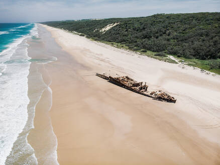 Aerial view of the Maheno Shipwreck washed up on the beach, Fraser Island, Australia - AAEF08918