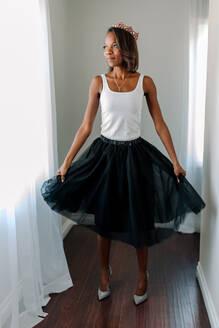 Beautiful slender African American woman in tiara, tank top & heels - CAVF84649