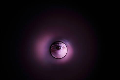 Cropped Eye Of Person Peeking Through Tube - EYF05195