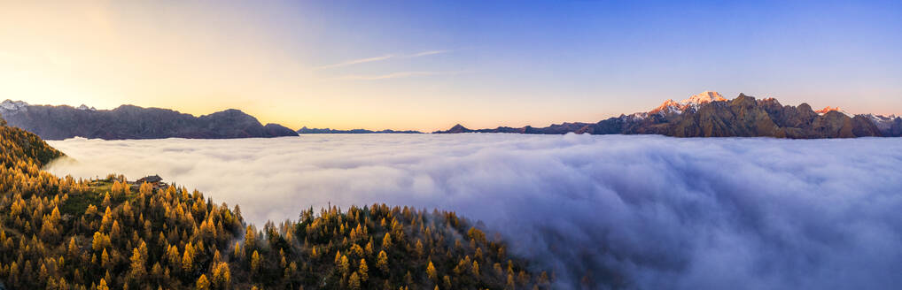 Aerial view of Malenco valley covered by fog at sunrise, Valmalenco, Valtelllina, Lombardy, Italy, Europe - RHPLF15317