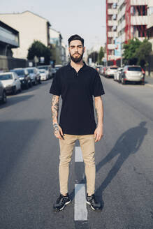 Portrait of a confident stylish young man standing on the street in the city - MEUF00778