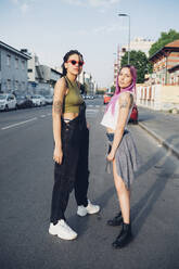 Portrait of two young women standing on the street in the city - MEUF00799