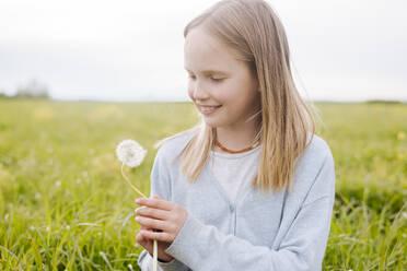 Portrait of smiling girl with dandelion - EYAF01134
