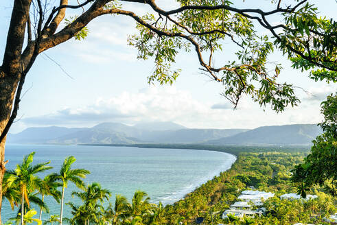 Aerial view of seascape and mountains against sky at Port Douglas, Queensland, Australia - KIJF03090