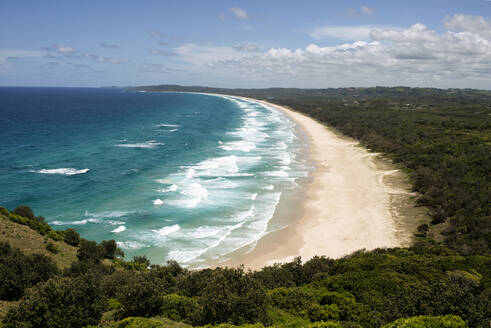 Aerial view of Tallow Beach against sky at Byron Bay, Queensland, Australia - KIJF03102