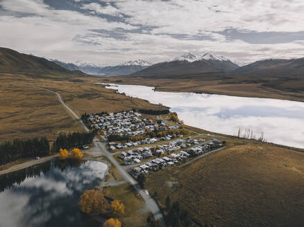 Lake Clearwater village with the Southern Alps in the background. NZ - CAVF85398