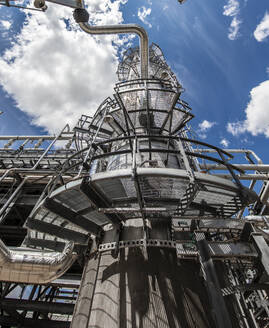 Natural gas processing plant structures with blue sky - CAVF85437