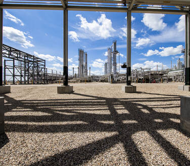 Natural gas plant structures against blue sky - CAVF85461