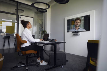 Business people on video conference - RBF07763