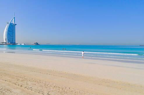 Burj Al Arab Hotel By Beach Against Clear Blue Sky - EYF06953