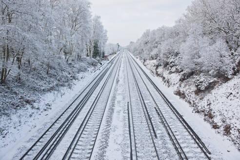 Train tracks in frozen winter landscape in south England - CAVF85648