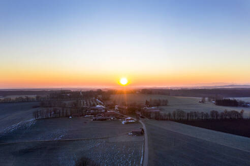 Germany, Bavaria, Dietramszell, Drone view of countryside village at sunrise - LHF00783