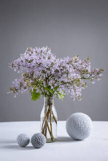 Wool spheres and bottle with blooming lilacs - OJF00405